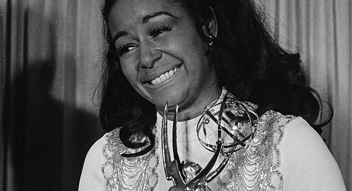 """Actress Gail Fisher holding the Best Supporting Actress in a series Emmy she won for the series """"Mannix"""". (Courtesy Everett Collection)"""