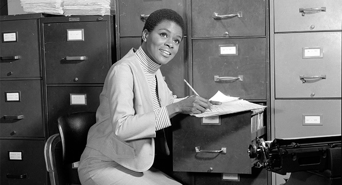 American actress Cicily Tyson (as Jane Foster) works at a filing cabinet in a scene from an episode of the television show 'East Side/West Side,' New York, New York, October 18, 1963. (Photo by CBS Photo Archive/Getty Images)