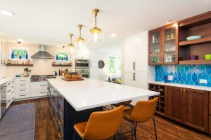 A renovated kitchen with tile backsplash