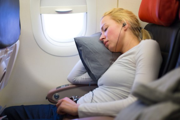 Woman sleeping in economy class