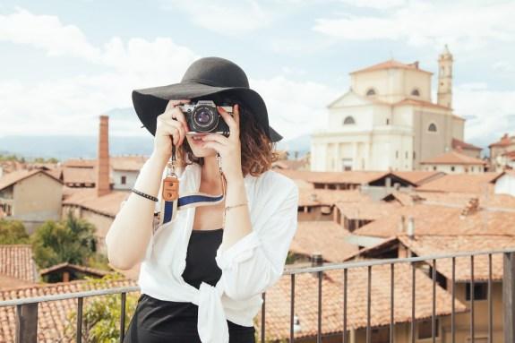 Woman takes photographs at tourist spot
