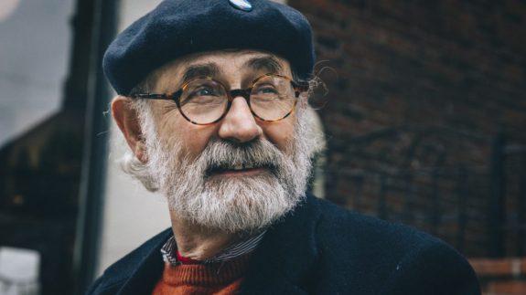 Older nomad in distinguished glasses