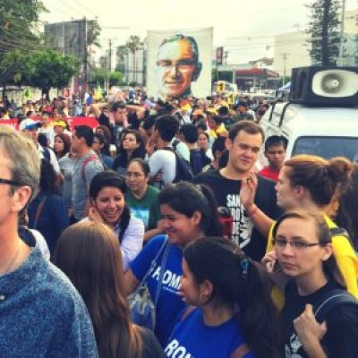 U.S. Jesuit university students participating in the CASA program join pilgrims in a procession in honor of Romero in March 2015. [Credit: Kevin Yonkers-Talz]