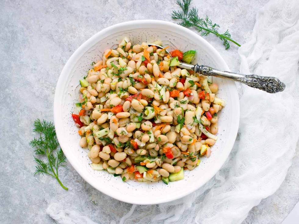 Herbed White Bean Picnic Salad, served family-style, in a bowl. Recipe at SoupAddict.com