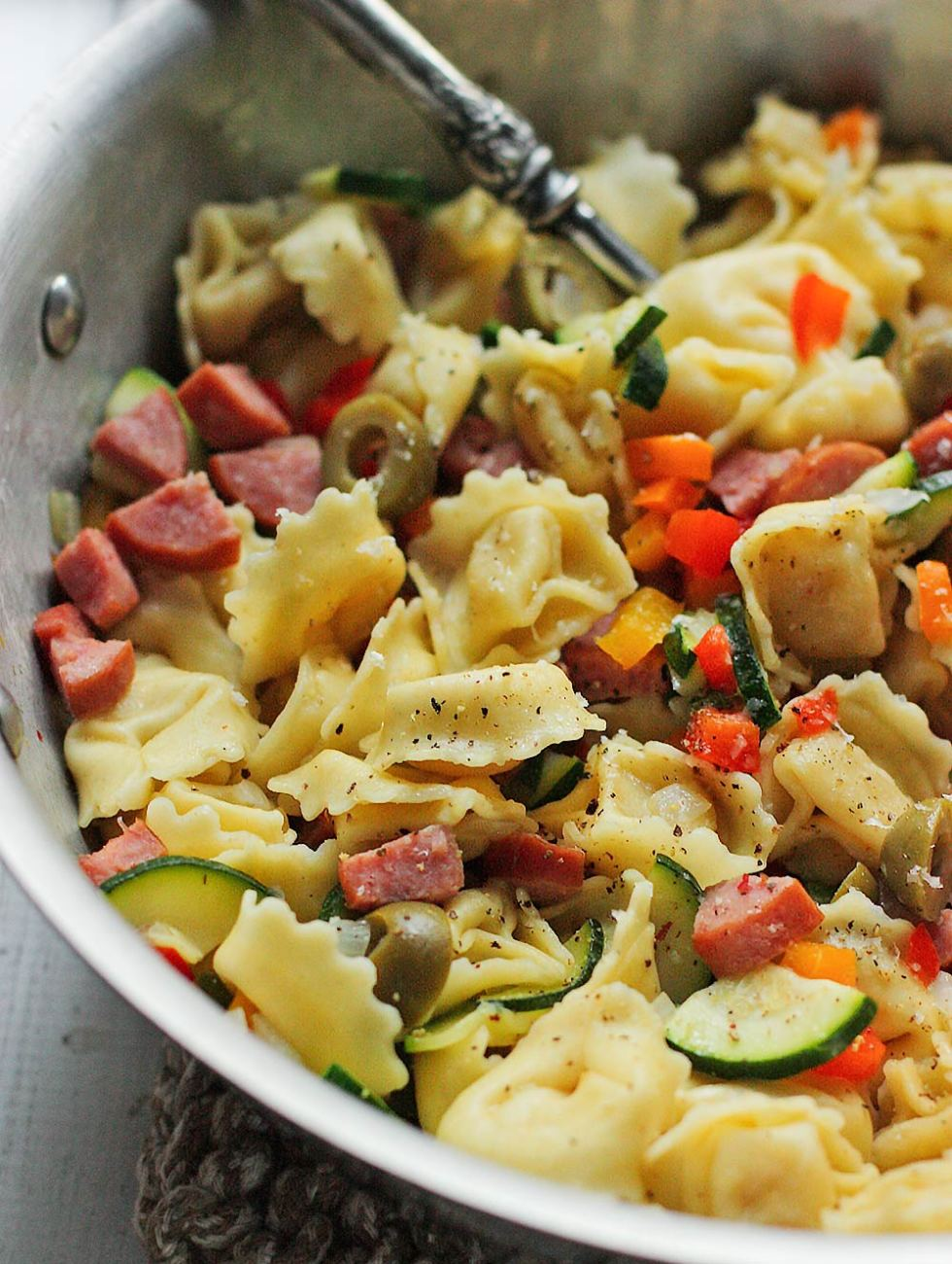 Smoked Turkey Sausage Tortellini Vegetable Saute with Garlic Sauce from Soupaddict.com