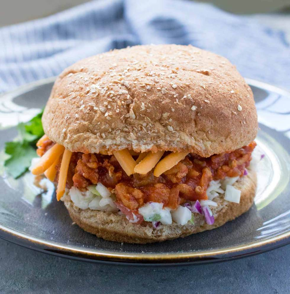 Turkey Sloppy Joes with cheese and slaw on a bun. Recipe at SoupAddict.com