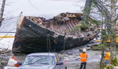 Excavators demolish the tug Challenger on March 8, 2016 (Photo by David Purdy/KTOO)