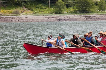 Members of the One People Canoe Society push during the last leg of their journey on Wednesday, June 8, 2016, near Juneau, Alaska. The group began the trip to Juneau from Angoon on June 2. Their trip is the unofficial beginning of Celebration. (Photo by Rashah McChesney/KTOO)
