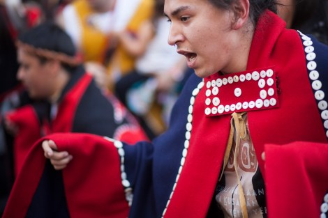 Austin Tagaban, Tlingit from Juneau, dances during a processional and grand entrance on Wednesday, June 8, 2016, near Juneau, Alaska. Celebration is a biennial festival of Tlingit, Haida and Tsimshian tribal members put on by the Sealaska Heritage Institute. (Photo by Rashah McChesney/KTOO)