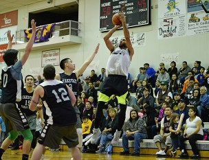 Angoon's Clayton Edwin scores two of his 55 points against Yakutat during their elimination game in the B-Bracket of the Juneau Lions Club 71st Annual Gold Medal Basketball Tournament at Juneau-Douglas High School on Tuesday. Angoon won 84-76. (Photo courtesy Klas Stolpe)