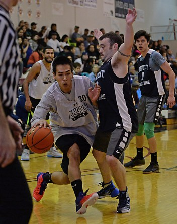 Angoon's Jeremiah Jack (30) is pressured by Yakutat's Adam Johnson during their elimination game in the B-Bracket of the Juneau Lions Club 71st Annual Gold Medal Basketball Tournament at Juneau-Douglas High School on Tuesday. Angoon won 84-76. (Photo courtesy Klas Stolpe)