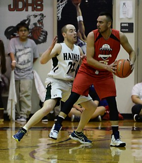 Haines' Jordan Baumgartner (24) defends Hoonah's David Lindstrom (55) during their B-Bracket semifinal in the Juneau Lions Club 71st Annual Gold Medal Basketball Tournament at Juneau-Douglas High School on Thursday. Haines won 77-63. (Photo courtesy Klas Stolpe)