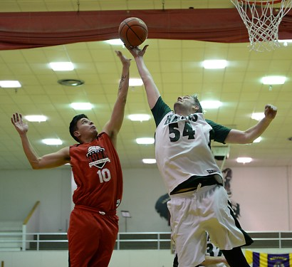 Hoonah's Charles Carteeti (10) and Haines' Ben Egolf (54) go for a rebound during their B-Bracket semifinal in the Juneau Lions Club 71st Annual Gold Medal Basketball Tournament at Juneau-Douglas High School on Thursday. Haines won 77-63. (Photo courtesy Klas Stolpe)