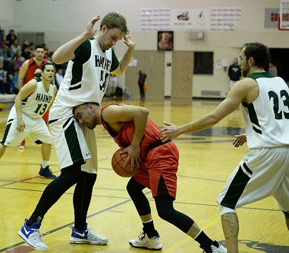 Hoonah's David Lindstrom (55) tries to force his way past Haines' Ben Egolf (54) during their B-Bracket semifinal in the Juneau Lions Club 71st Annual Gold Medal Basketball Tournament at Juneau-Douglas High School on Thursday. Haines won 77-63. (Photo courtesy Klas Stolpe)