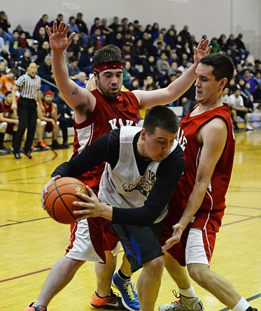 Angoon's John Crossman Jr. (12) is defended by Kake's Shea Jackson and Dean Cavanaugh during Kake's 86-73 win in the Juneau Lions Club 71st Annual Gold Medal Basketball Tournament at JDHS on Sunday, March 19, 2017. (Photo courtesy Klas Stolpe)