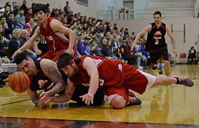Hoonah's Jonathan Torres and Kake's Shea Jackson battle for a loose ball during their B-Bracket quarterfinal on Monday. Hoonah won 61-57. (Photo courtesy Klas Stolpe)