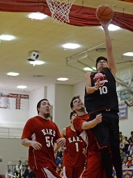 Hoonah's Charles Carteeti (10) scores over Kake's Deion Jackson (54), Xavier Friday (1) and Tracy Jackson in their B-Bracket game of the Juneau-Lions Club 71st Annual Gold Medal Basketball Tournament at Juneau-Douglas High School on Monday. Hoonah won 61-57. (Photo courtesy Klas Stolpe)