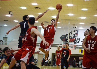 Kake's Xavier Friday (1) floats a shot over Hoonah's George Fisher (1) in their B-Bracket game of the Juneau-Lions Club 71st Annual Gold Medal Basketball Tournament at Juneau-Douglas High School on Monday. Hoonah won 61-57. (Photo courtesy Klas Stolpe)