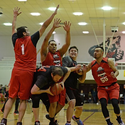 Wrangell's Jason Clark (44) secures a rebound against Hoonah's George Fisher (1), Jaylin Prince (33) and DJ Lindstrom (55), as teammate Eric James muscles in during their B-Bracket elimination game in the Juneau Lions Club 71st Annual Gold Medal Basketball Tournament at Juneau-Douglas High School on Friday. Hoonah won 85-77. (Photo courtesy Klas Stolpe)