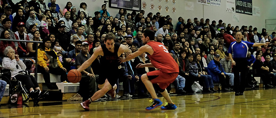 Wrangell's Ryan Howell drives against Hoonah's Devin Moritz (3) during their B-Bracket elimination game in the Juneau Lions Club 71st Annual Gold Medal Basketball Tournament at Juneau-Douglas High School on Friday. Hoonah won 85-77. (Photo courtesy Klas Stolpe)