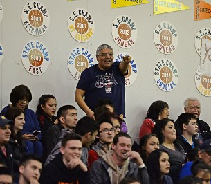 A Hoonah fan cheers on his team against Wrangell in the B-Bracket elimination game in the Juneau Lions Club 71st Annual Gold Medal Basketball Tournament at Juneau-Douglas High School on Friday. Hoonah won 85-77. (Photo courtesy Klas Stolpe)