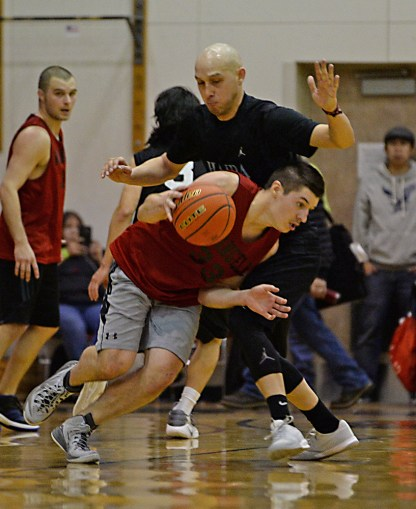 Wrangell's Andrew Versteeg (33) is pressured by Hydaburg's Devin Edenshaw during a B-Bracket elimination game in the Juneau Lions Club 71st Annual Gold Medal Basketball Tournament at Juneau-Douglas High School on Wednesday. Wrangell won 87-68. (Photo courtesy Klas Stolpe)