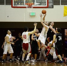 Hoonah and Angoon players battle for a rebound during their C-Bracket elimination game at the Juneau Lions Club 71st Annual Gold Medal Basketball Tournament at Juneau-Douglas High School on Tuesday. Hoonah won 88-66. (Photo courtesy Klas Stolpe)