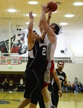 Angoon's James Wilson (24) fouls Hoonah's Donald Dybdahl on a shot during their C-Bracket elimination game at the Juneau Lions Club 71st Annual Gold Medal Basketball Tournament at Juneau-Douglas High School on Tuesday. Hoonah won 88-66. (Photo courtesy Klas Stolpe)