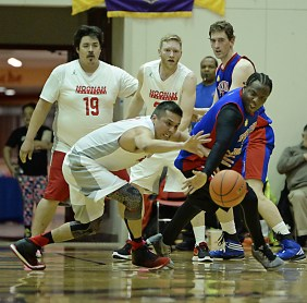 Hoonah's Anthony Lindoff (0) and Filcom's Rob Ridgeway (4) go for a loose ball during their C-Bracket elimination game in the Juneau Lions Club 71st Annual Gold Medal Basketball Tournament at Juneau-Douglas High School on Wednesday. Hoonah won 66-62. (Photo courtesy Klas Stolpe)