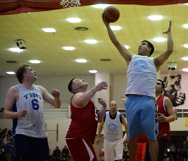 James Gang forward Levi Hotch grabs a rebound over Kake's Jess Ross (54) during their C-bracket elimination game at the Juneau Lions Club 71st Annual Gold Medal Basketball Tournament at Juneau-Douglas High School on Tuesday. James Gang won 88-52. (Photo courtesy Klas Stolpe)