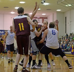Klukwan's Andrew Friske is defended by James Gang's Russ Stevens and Sean Joslyn (6) during C-Bracket championship of the Juneau Lions Club 71st Annual Gold Medal Basketball Tournament at Juneau-Douglas High School on Saturday. Klukwan won 107-97. (Photo courtesy Klas Stolpe)