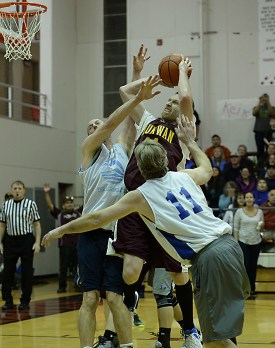 Klukwan's Andrew Friske shoots under pressure from James Gang's Jim Carson (20) and Doug Drazkowski (11) during C-Bracket championship of the Juneau Lions Club 71st Annual Gold Medal Basketball Tournament at Juneau-Douglas High School on Saturday. Klukwan won 107-97. (Photo courtesy Klas Stolpe)