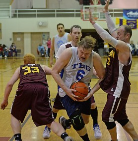 James Gang's Sean Joslyn (6) secures a reboud against Klukwan during C-Bracket championship of the Juneau Lions Club 71st Annual Gold Medal Basketball Tournament at Juneau-Douglas High School on Saturday. Klukwan won 107-97. (Photo courtesy Klas Stolpe)