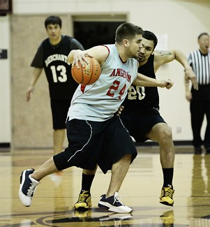 Angoon's James Wilson (24) is defended by Metlakatla's Willie Hayward (20) in a C Bracket game at the Juneau Lions Club 71st Annual Gold Medal Basketball Tournament at JDHS on Sunday, March 19, 2017. Metlakatla won 85-72. (Photo courtesy Klas Stolpe)