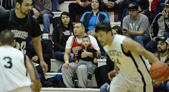 A young fan watches basketball action during the C-Bracket quarterfinal in the Juneau-Lions Club 71st Annual Gold Medal Basketball Tournament at Juneau-Douglas High School on Monday. Metlakatla defeated Yakutat 101-72. (Photo courtesy Klas Stolpe)