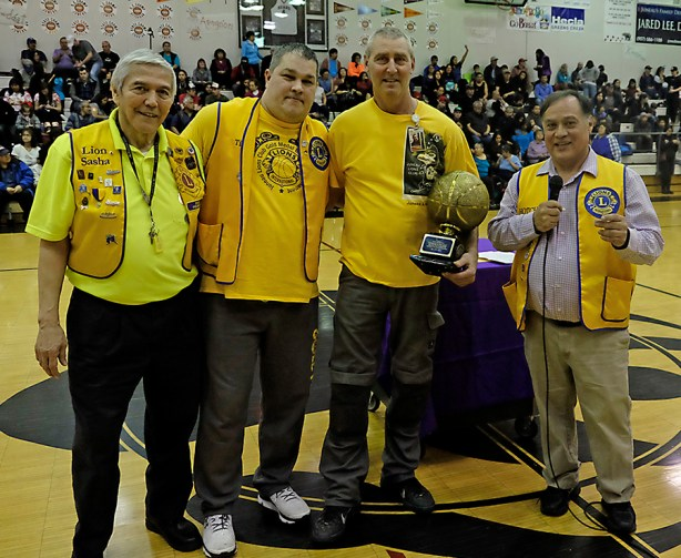 Steve Brandner was presented with a trophy for his dedication to the Juneau Lions Club. Left-to-right are Lion Sasha, Lion Tim, Brandner and Lion Hotch. (Photo courtesy Klas Stolpe)