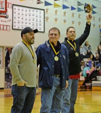 Klukwan's Stuart DeWitt, referee Joe Thompson and Kake's Nick Davis acknowledge the crowd after being inducted into the Gold Medal Hall of Fame at the Juneau Lions Club 71st Annual Gold Medal Basketball Tournament at Juneau-Douglas High School on Friday. (Photo courtesy Klas Stolpe)