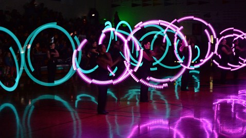 Members of the Juneau-Douglas High School dance team performed their light routine at the Juneau Lions Club 71st Annual Gold Medal Basketball Tournament.