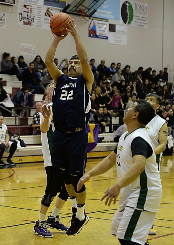 Angoon's Edward Jack (22) scores against Sitka during a Masters Bracket game of the Juneau-Lions Club 71st Annual Gold Medal Basketball Tournament at Juneau-Douglas High School on Monday. Angoon won 65-56. (Photo courtesy Klas Stolpe)