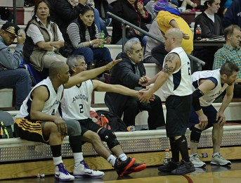 Angoon players Kevin Mitchell, Roger Williams (2), Paul Johnson and coach Albert Kookesh acknowledge their play against Kake during their Masters Bracket elimination game in the Juneau Lions Club 71st Annual Gold Medal Basketball Tournament at Juneau-Douglas High School on Friday. Kake won 94-67. (Photo courtesy Klas Stolpe)
