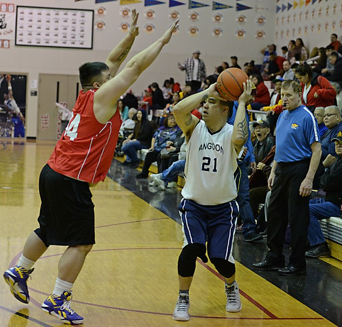 Kake's Tony Abbott (34) defends Angoon's Frank Jack (21) during their Masters Bracket elimination game in the Juneau Lions Club 71st Annual Gold Medal Basketball Tournament at Juneau-Douglas High School on Friday. Kake won 94-67. (Photo courtesy Klas Stolpe)
