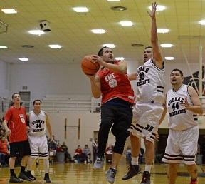 Kake's Rudy Bean (23) shoots against Hoonah's Albert Hinchman (33) during the Master's Bracket championship of the Juneau Lions Club 71st Annual Gold Medal Basketball Tournament at Juneau-Douglas High School on Saturday. Hoonah won 80-78. (Photo courtesy Klas Stolpe)