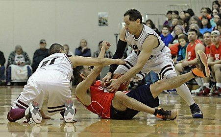 Kake's Jay Peterson tries to call time out as Hoonah's Louie White Sr. and Greg Garcia defend during the Master's Bracket championship of the Juneau Lions Club 71st Annual Gold Medal Basketball Tournament at Juneau-Douglas High School on Saturday. Hoonah won 80-78. (Photo courtesy Klas Stolpe)