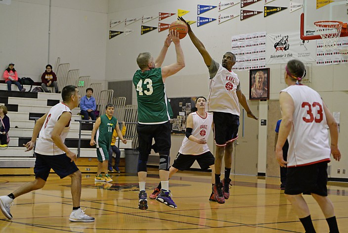 Kake's Kip Howard (24) checks a shot by Sitka's Norm Staton (43) during their Masters Bracket elimination game in the Juneau Lions Club 71st Annual Gold Medal Basketball Tournament at Juneau-Douglas High School on Wednesday. Kake won 67-51. (Photo courtesy Klas Stolpe)