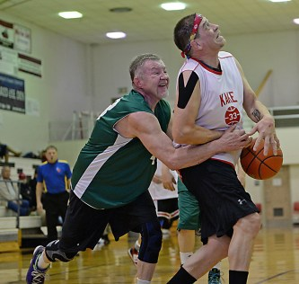 Kake's Nick Davis (33) is fouled by Sitka's Norm Staton (43) during their Masters Bracket elimination game in the Juneau Lions Club 71st Annual Gold Medal Basketball Tournament at Juneau-Douglas High School on Wednesday. Kake won 67-51. (Photo courtesy Klas Stolpe)
