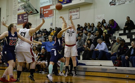 Hoonah's Mariah Martin (23) shoots a 3-pointer against Yakutat during their Womens Bracket elimination game in the Juneau Lions Club 71st Annual Gold Medal Basketball Tournament at Juneau-Douglas High School on Friday. Hoonah won 56-53. (Photo courtesy Klas Stolpe)