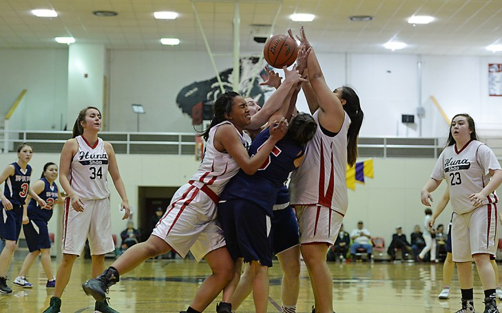 Hoonah and Yakutat players battle for a rebound during their Womens Bracket elimination game in the Juneau Lions Club 71st Annual Gold Medal Basketball Tournament at Juneau-Douglas High School on Friday. Hoonah won 56-53. (Photo courtesy Klas Stolpe)