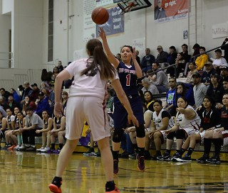 Yakutat's Kaitlyn Ivers (1) shoots over Hoonah's Alice Johnson during their Womens Bracket elimination game in the Juneau Lions Club 71st Annual Gold Medal Basketball Tournament at Juneau-Douglas High School on Friday. Hoonah won 56-53. (Photo courtesy Klas Stolpe)