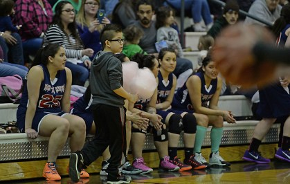 A young fan protects his cotton candy during the Yakutat and Hoonah Womens Bracket elimination game in the Juneau Lions Club 71st Annual Gold Medal Basketball Tournament at Juneau-Douglas High School on Friday. Hoonah won 56-53. (Photo courtesy Klas Stolpe)