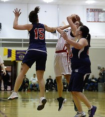 Yakutat's Lorena Williams (15) fouls Hoonah's LaDonna Johnson during their Womens Bracket elimination game in the Juneau Lions Club 71st Annual Gold Medal Basketball Tournament at Juneau-Douglas High School on Friday. Hoonah won 56-53. (Photo courtesy Klas Stolpe)